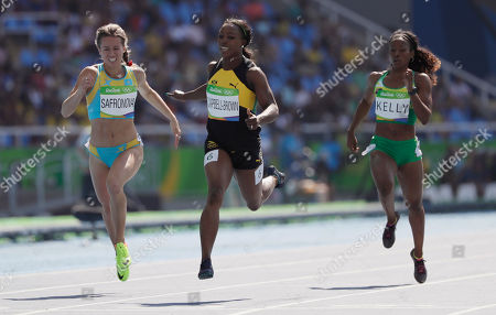 Jamaica's Veronica Campbell-Brown, center, British Virgin Islands's Ashley Kelly, right, and Kazakhstan's Olga Safronova compete in a women's 200-meter heat during the athletics competitions of the 2016 Summer Olympics at the Olympic stadium in Rio de Janeiro, Brazil