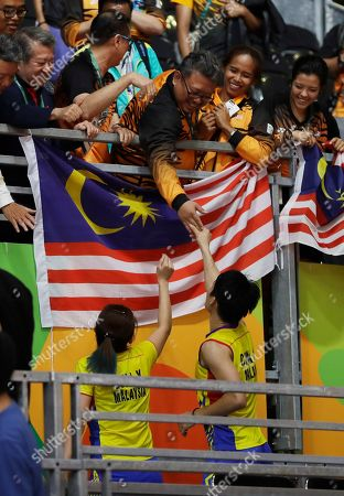 Chan Peng Soon, Goh Liu Ying Malaysia's Chan Peng Soon, right, and Goh Liu Ying celebrate after beating China's Ma Jin, right, and Xu Chen during the Semi-finals of mixed doubles match