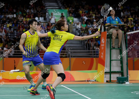 Chan Peng Soon, Goh Liu Ying Malaysia's Chan Peng Soon, left, and Goh Liu Ying return a shot to China's Ma Jin, right, and Xu Chen during the Semi-finals of mixed doubles match