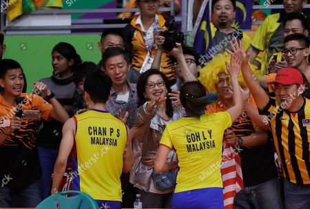 Chan Peng Soon, Goh Liu Ying Malaysia's Chan Peng Soon, left, and Goh Liu Ying celebrate with their supporters after beating China's Ma Jin, right, and Xu Chen during the Semi-finals of mixed doubles match