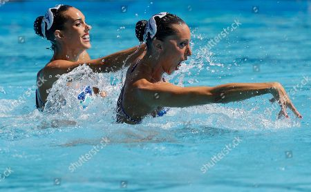 Spain's Ona Carbonell and Gemma Mengual compete during the synchronized swimming duet technical routine preliminary round in the Maria Lenk Aquatic Center at the 2016 Summer Olympics in Rio de Janeiro, Brazil