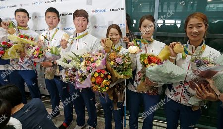 Choi Mi-sun, Ki Bo-bae, Chang Hye-jin, Lee Seung-yun, Kim Woo-jin, Ku Bon-chan From right; South Korea's archers Choi Mi-sun, Ki Bo-bae, Chang Hye-jin, Lee Seung-yun, Kim Woo-jin and Ku Bon-chan pose with their gold medals after returning home from the Rio Olympics at the Incheon International Airport in Incheon, South Korea, . South Korean archers returned home on Tuesday after a successful Rio Olympics campaign in which they won all archery categories, the feat that was achieved for the first time in the Olympics history