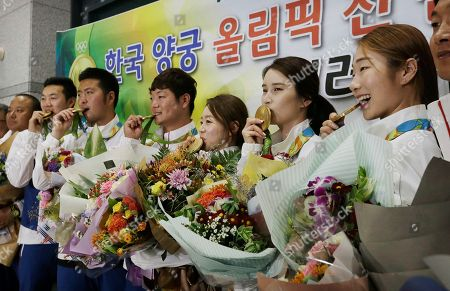 Choi Mi-sun, Ki Bo-bae, Chang Hye-jin, Lee Seung-yun, Kim Woo-jin, Ku Bon-chan From right; South Korean archers Choi Mi-sun, Ki Bo-bae, Chang Hye-jin, Lee Seung-yun, Kim Woo-jin and Ku Bon-chan pose with their gold medals after returning from the Rio Olympics at the Incheon International Airport in Incheon, South Korea, . South Korean archers returned home on Tuesday after a successful Rio Olympics campaign in which they won all archery categories, the feat that was achieved for the first time in the Olympics history