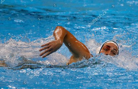 Blood runs down the eyebrow of Australia's Nicola Zagame during a women's water polo quarterfinal match against Hungary at the 2016 Summer Olympics in Rio de Janeiro, Brazil