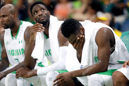 Stock Picture of Al-Farouq Aminu, Ekene Ibekwe, Chamberlain Oguchi Nigeria's Al-Farouq Aminu, left, Ekene Ibekwe, center, and Nigeria's Chamberlain Oguchi, right, sit on the bench during the final moments of a men's basketball game against Brazil