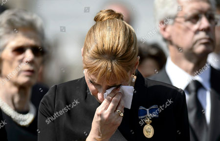 Princess Marie, daughter of Romania's last monarch King Michael, wipes her tears during a religious service ahead of the burial of Anne of Romania, wife of Romania's last monarch King Michael, in Bucharest, . Romanians and Moldovans are observing a national day of mourning Saturday ahead of the burial of Anne of Romania, the wife of Michael, the last king of Romania