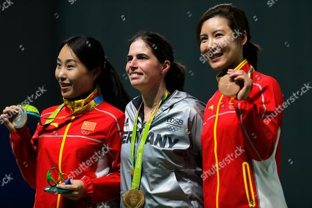 Stock Photo of Gold medalist Barbara Engleder, center, of Germany is flanked by silver medalist Zhang Binbin, left, of China and bronze medalist Du Li, right, of China during the award ceremony for the women's 50 meter rifle 3 positions event at Olympic Shooting Center at the 2016 Summer Olympics in Rio de Janeiro, Brazil