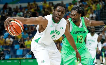 Nigeria's Ike Diogu (6) catches a pass in front of Brazil's Nene Hilario (13) during a basketball game
