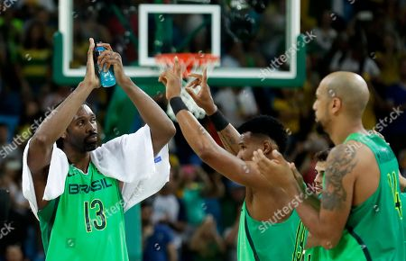 Brazil's Nene Hilario (13) celebrates with teammates after a basketball game against Nigeria