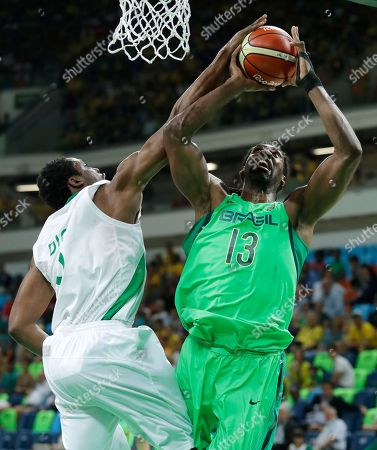 Stock Picture of Brazil's Nene Hilario (13) shoots over Nigeria's Ike Diogu, left, during a basketball game