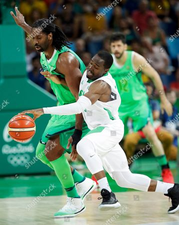 Stock Image of Brazil's Nene Hilario, left, tries to steal the ball from Nigeria's Michael Umeh, right, during a basketball game