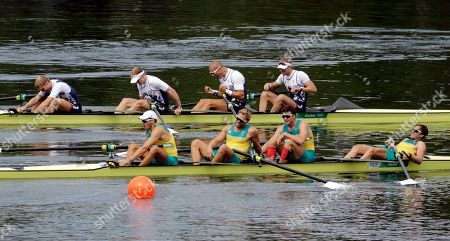 William Lockwood, Joshua Dunkley-Smith, Joshua Booth and Alexander Hill, of Australia, react to their silver as Alex Gregory, Mohamed Sbihi, George Nash and Constantine Louloudis, of Britain, top celebrate their gold in the men's rowing four final during the 2016 Summer Olympics in Rio de Janeiro, Brazil