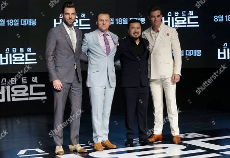 """Zachary Quinto, Chris Pine, Simon Pegg, Justin Lin Director Justin Lin, second right, poses with actors, from left, Zachary Quinto, Simon Pegg and Chris Pine, during a promotional event for their latest film """"Star Trek Beyond"""" in Seoul, South Korea,. The film be released in South Korea on Aug. 18"""