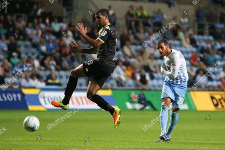 Coventry City forward Marcus Tudgay (20)  with a shot late on in the game during the EFL Sky Bet League 1 match between Coventry City and Bury at the Ricoh Arena, Coventry