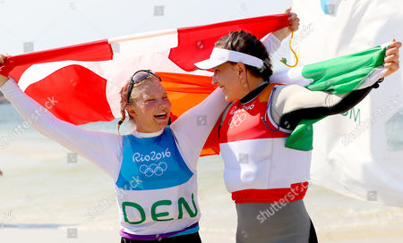Women?s Laser Radial Class Medal Race. Ireland's Annalise Murphy celebrates winning a silver medal with bronze medalist Anne-Marie Rindom from Denmark