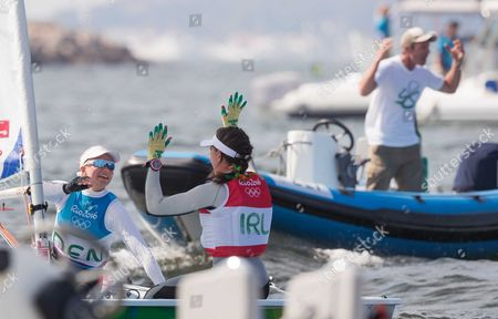 Sailing - Women?s Laser Radial Medal Race. Ireland's Annalise Murphy celebrates winning a silver medal with bronze medalist Anne-Marie Rindom from Denmark