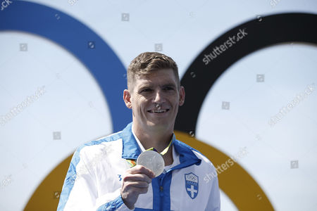 Spyridon Gianniotis, of Greece, holds the silver medal he won in the men's marathon swimming competition at the 2016 Summer Olympics in Rio de Janeiro, Brazil, Tuesday, Aug. 16, 2016.
