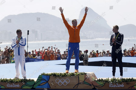Gold medalist Ferry Weertman, of the Netherlands, center, is joined on the podium by silver medalist Spyridon Gianniotis, of Greece, left, and bronze medalist Marc-Antoine Olivier, of France, after the men's marathon swimming competition at the 2016 Summer Olympics in Rio de Janeiro, Brazil, Tuesday, Aug. 16, 2016.