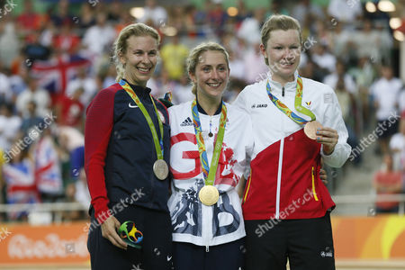 Cyclists, from left, silver medalist Sarah Hammer of the United States, gold medalist Laura Trott of Britain and bronze medalist Jolien D'Hoore of Belgium pose on the podium of the women's omnium cycling event at the Rio Olympic Velodrome during the 2016 Summer Olympics in Rio de Janeiro, Brazil, Tuesday, Aug. 16, 2016.