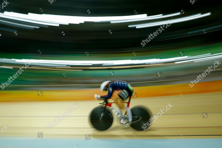 With slow shutter speed, Sarah Hammer of the United States competes in the women's omnium cycling time trial at the Rio Olympic Velodrome during the 2016 Summer Olympics in Rio de Janeiro, Brazil