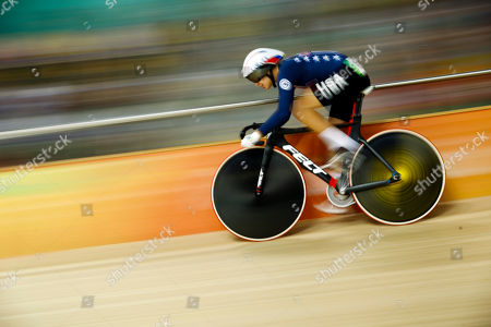 With slow shutter speed, Sarah Hammer of the United States competes in the women's omnium cycling flying lap at the Rio Olympic Velodrome during the 2016 Summer Olympics in Rio de Janeiro, Brazil