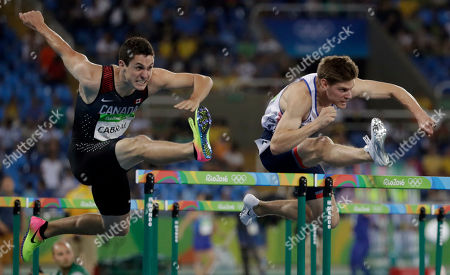 Canada's Johnathan Cabral, left, and Britain's Lawrence Clarke compete in a men's 110-meter hurdles semifinal during the athletics competitions of the 2016 Summer Olympics at the Olympic stadium in Rio de Janeiro, Brazil