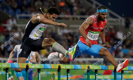 Puerto Rico's Javier Culson, left, and Turkey's Yasmani Copello compete in a men's 400-meter hurdles semifinal during the athletics competitions of the 2016 Summer Olympics at the Olympic stadium in Rio de Janeiro, Brazil
