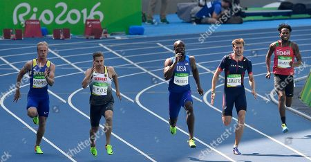 From left, Ukraine's Ihor Bodrov, Germany's Julian Reus, United States' Lashawn Merritt, France's Christophe Lemaitre and Carvin Nkanata of Kenya compete in a men's 200-meter heat during the athletics competitions of the 2016 Summer Olympics at the Olympic stadium in Rio de Janeiro, Brazil