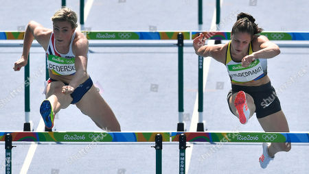 Norway's Isabelle Pedersen, left, and Germany's Nadine Hildebrand compete in a women's 100-meter hurdles heat during the athletics competitions of the 2016 Summer Olympics at the Olympic stadium in Rio de Janeiro, Brazil