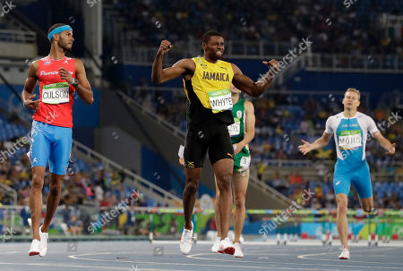 Jamaica's Annsert Whyte, center, wins a men's 400-meter hurdles semifinal ahead of second placed Puerto Rico's Javier Culson, left, during the athletics competitions of the 2016 Summer Olympics at the Olympic stadium in Rio de Janeiro, Brazil