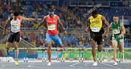 Jamaica's Annsert Whyte, center right, wins a men's 400-meter hurdles semifinal ahead of second placed Puerto Rico's Javier Culson, third placed Turkey's Yasmani Copello and fifth placed South Africa's L.j. van Zyl during the athletics competitions of the 2016 Summer Olympics at the Olympic stadium in Rio de Janeiro, Brazil
