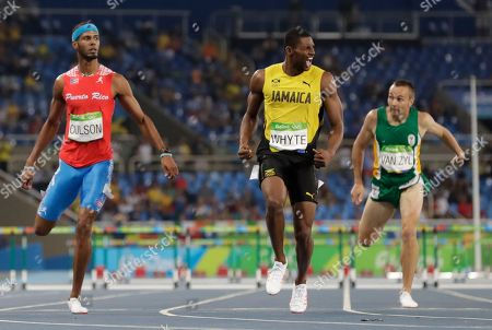 Jamaica's Annsert Whyte, center, wins a men's 400-meter hurdles semifinal ahead of second placed Puerto Rico's Javier Culson, and fifth placed South Africa's L.j. van Zyl during the athletics competitions of the 2016 Summer Olympics at the Olympic stadium in Rio de Janeiro, Brazil