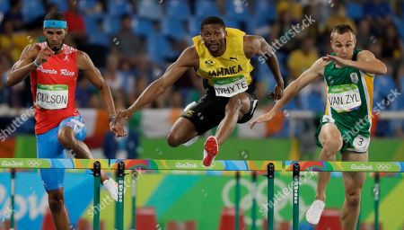 Puerto Rico's Javier Culson, left, Jamaica's Annsert Whyte and South Africa's L.j. van Zyl compete in a men's 400-meter hurdles semifinal during the athletics competitions of the 2016 Summer Olympics at the Olympic stadium in Rio de Janeiro, Brazil