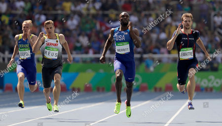 From left, Ukraine's Ihor Bodrov, Germany's Julian Reus, United States' Lashawn Merritt and France's Christophe Lemaitre compete in a men's 200-meter heat during the athletics competitions of the 2016 Summer Olympics at the Olympic stadium in Rio de Janeiro, Brazil