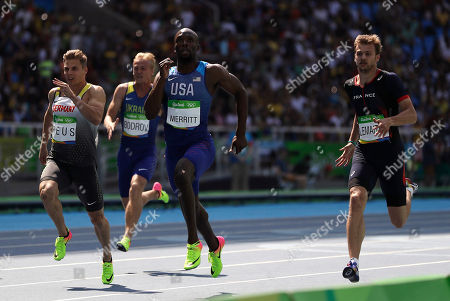 Germany's Julian Reus, United States' Lashawn Merritt and France's Christophe Lemaitre, from left, compete in a men's 200-meter heat during the athletics competitions in the Olympic stadium of the 2016 Summer Olympics in Rio de Janeiro, Brazil