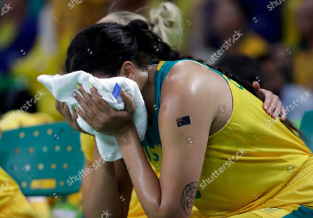 Australia's Elizabeth Cambage holds a towel to her face during the team's loss to Serbia in a women's quarterfinal round basketball game at the 2016 Summer Olympics in Rio de Janeiro, Brazil