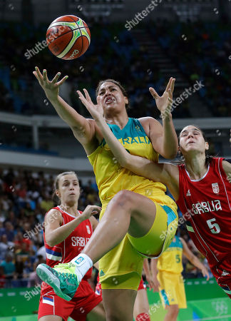 Australia's Elizabeth Cambage (8) drives to the basket past Serbia's Sonja Petrovic (5) during a women's quarterfinal round basketball game at the 2016 Summer Olympics in Rio de Janeiro, Brazil