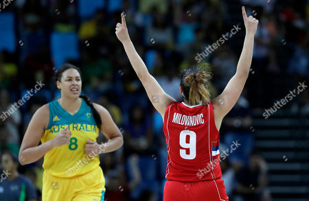 Serbia's Jelena Milovanovic (9) celebrates a score in front of Australia's Elizabeth Cambage (8) after she scored during a women's quarterfinal round basketball game at the 2016 Summer Olympics in Rio de Janeiro, Brazil