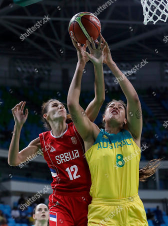 Serbia's Dragana Stankovic (12) and Australia's Elizabeth Cambage reach for a rebound during a women's quarterfinal round basketball game at the 2016 Summer Olympics in Rio de Janeiro, Brazil