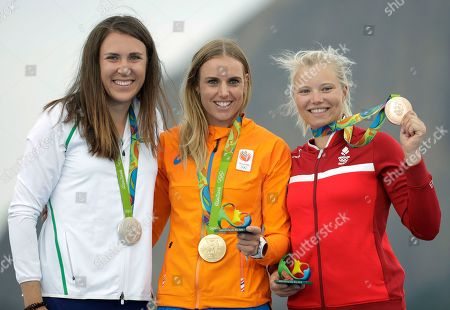 From left to right, silver medalist, Annalise Murphy, of Ireland, gold medalist Marit Bouwmeester, of the Netherlands, and bronze medalist Anne-Marie Rindom, of Denmark, pose with their medals for the women's Laser Radial sailing race at the 2016 Summer Olympics in Rio de Janeiro, Brazil