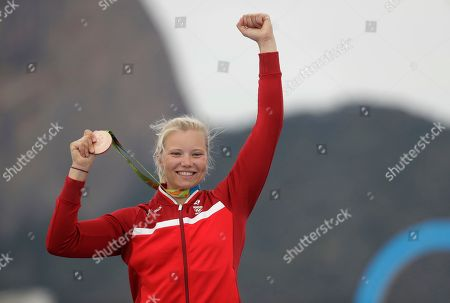 Anne-Marie Rindom, of Denmark, celebrates after winning bronze in the women's Laser Radial sailing race during the medals ceremony at the 2016 Summer Olympics in Rio de Janeiro, Brazil