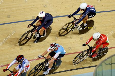 Laura Trott of Britain, top left, competes to win gold in the women's omnium cycling points race followed by silver medalist Sarah Hammer of the United States, top right, at the Rio Olympic Velodrome during the 2016 Summer Olympics in Rio de Janeiro, Brazil
