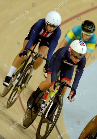 Laura Trott of Britain, right, competes to win gold in the women's omnium cycling points race followed by silver medalist Sarah Hammer of the United States, left, at the Rio Olympic Velodrome during the 2016 Summer Olympics in Rio de Janeiro, Brazil
