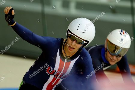 Sarah Hammer of the United States, left, celebrates winning the silver medal in the women's omnium cycling event at the Rio Olympic Velodrome during the 2016 Summer Olympics in Rio de Janeiro, Brazil, . To the right is gold medalist Laura Trott of Britain