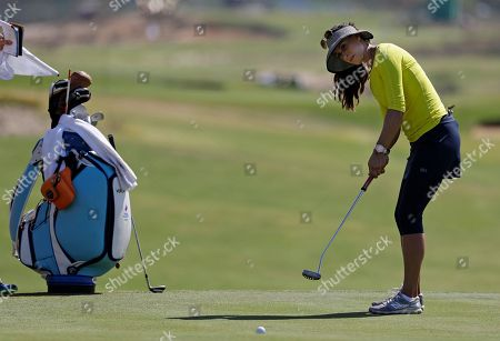 Stock Photo of Maria Verchenova of Russia putts on the fourth hole during a practice round for the women's golf event at the 2016 Summer Olympics in Rio de Janeiro, Brazil