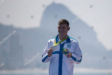 Stock Picture of Spyridon Gianniotis, of Greece, holds the silver medal he won in the men's marathon swimming competition at the 2016 Summer Olympics in Rio de Janeiro, Brazil