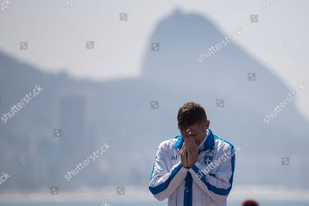 Spyridon Gianniotis, of Greece, reacts on the podium before receiving his silver medal in the men's marathon swimming competition at the 2016 Summer Olympics in Rio de Janeiro, Brazil