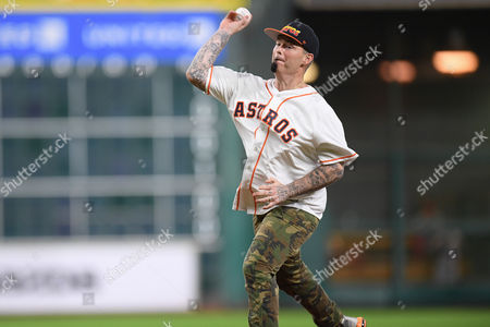 Rapper Paul Wall throws out the first pitch prior to a Major League Baseball game between the Houston Astros and the St. Louis Cardinals at Minute Maid Park in Houston, TX