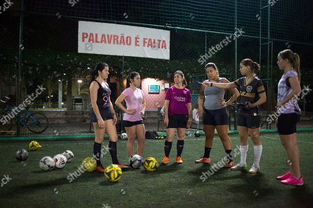 Stock Picture of Jamile Marques da Silva Jamile Marques, second right, who founded and coaches the neighborhood soccer team, gives instructions to her players as part of a practice session for an amateur soccer team in a condominium complex in Rio de Janeiro, Brazil. Every Friday after nightfall, teenage girls and young women make their way through the middle-class apartment complex and take over a field of emerald green grass.  The Friday night practice is the only time of the week when you will find women playing soccer here