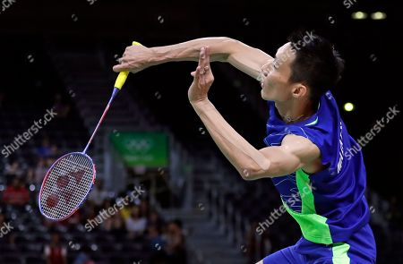 Lee Chong Wei, of Malaysia, serves to Chou Tien Chen, of Taiwan, during a men's singles quarterfinal badminton match at the 2016 Summer Olympics in Rio de Janeiro, Brazil
